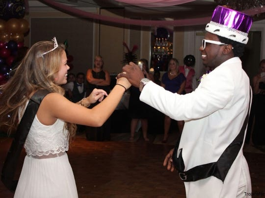 Ashley Schneller and Tupac Isme dance before he hands over his crown to Mitchell Weis.