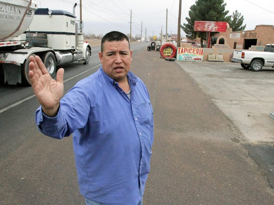 Rene Rodriguez, who owns Tommy's Body Shop at 11876 Socorro Road is unhappy about plans by the town of Socorro to annex the area, now in San Elizario. Rodriguez believes they will get nothing in return.