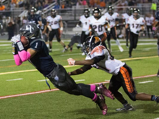 Dallastown's Jake Jansen, left, makes a diving catch while being covered by Northeastern's Michael Cooper during Friday's game. Jansen finished with six catches for 36 yards and caught the final two-point conversion pass as the Wildcats scored two fourth-quarter touchdowns to rally past the Bobcats, 15-12. Dallastown remained undefeated and took sole possession of the top spot in YAIAA Division I.