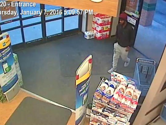 A surveillance photo shows a suspect wanted in connection with several credit fraud instances at area pharmacies.