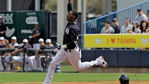 New York Yankees' Jorge Mateo celebrates after hitting a home run off Boston Red Sox starting pitcher Steven Wright during the third inning of a spring training baseball game Saturday, March 5, 2016, in Tampa, Fla. (AP Photo/Chris O'Meara)