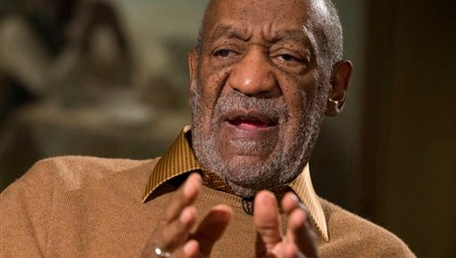 """In this Nov. 6 photo, entertainer Bill Cosby gestures during an interview about the upcoming exhibit, """"Conversations: African and African-American Artworks in Dialogue, """" at the Smithsonian's National Museum of African Art, in Washington. A Southern California woman has sued Cosby, claiming the comedian molested her around 1974 when she was 15 years old. Judith Huth claims in the sexual battery lawsuit filed Tuesday, Dec. 2, 2014. in Los Angeles that the molestation occurred in a bedroom of the Playboy Mansion."""