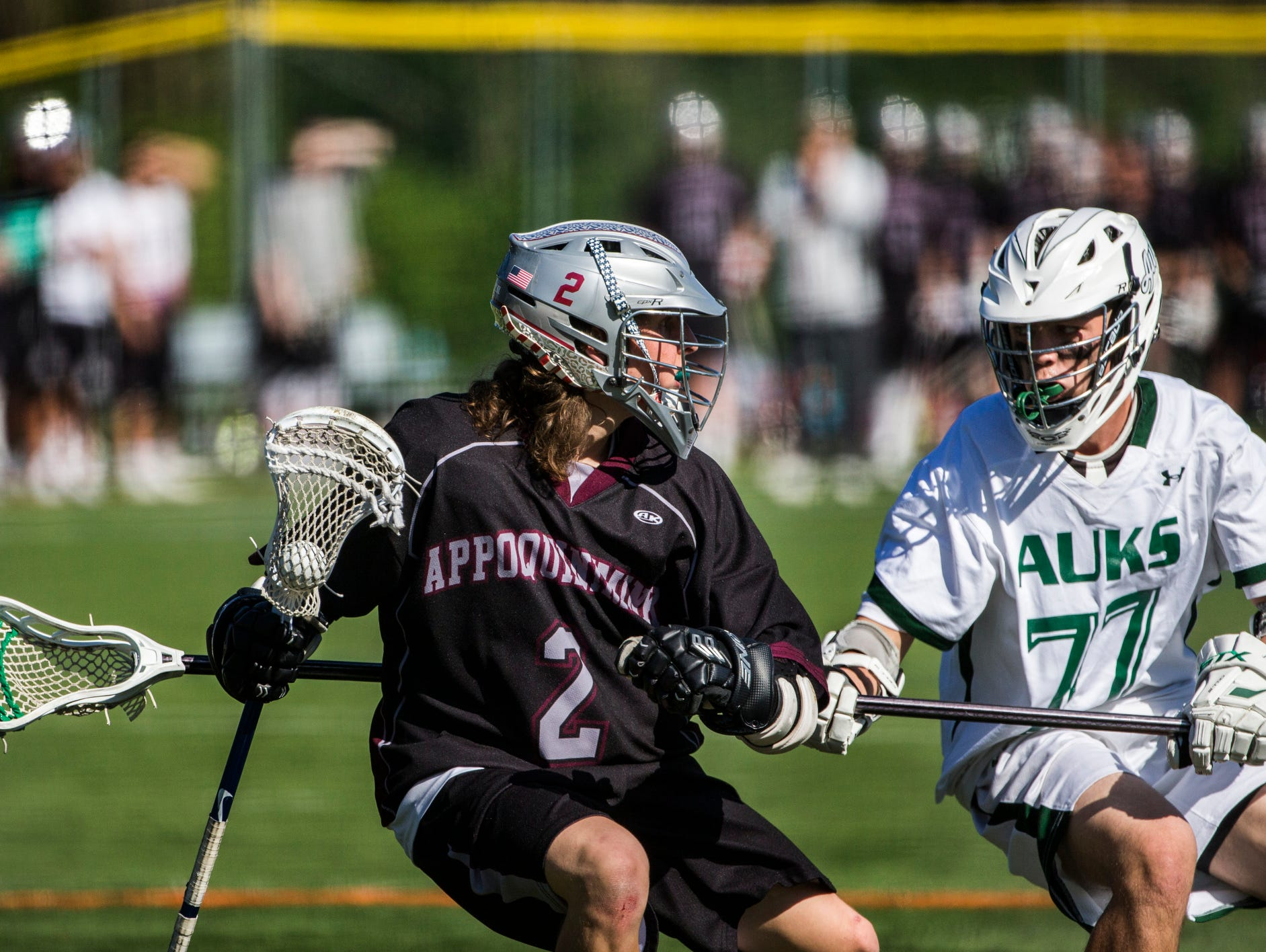 Appoquinimink's Logan Yoder (No. 2) works against Archmere's Ryan Whelan (No. 77) in the first quarter of Appoquinimink's 13-12 win over Archmere at Archmere Academy on Wednesday afternoon.