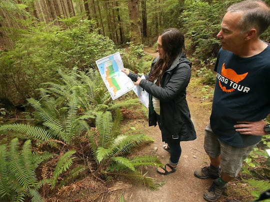 Susannah Hale and Mark Schorn pause on a trail to look