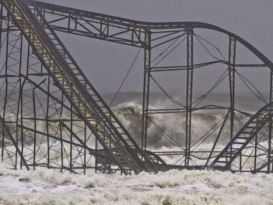 Waves crash into the Jet Star rollercoaster that sits