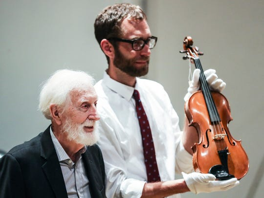 July 25, 2018 - Stax founder Jim Stewart, left, stands with Jeff Kollath, executive director of the Stax museum of American Soul Music, while showing off Stewart's fiddle during a ceremony where Stewart donated his fiddle to the Stax Museum of American Soul Music.