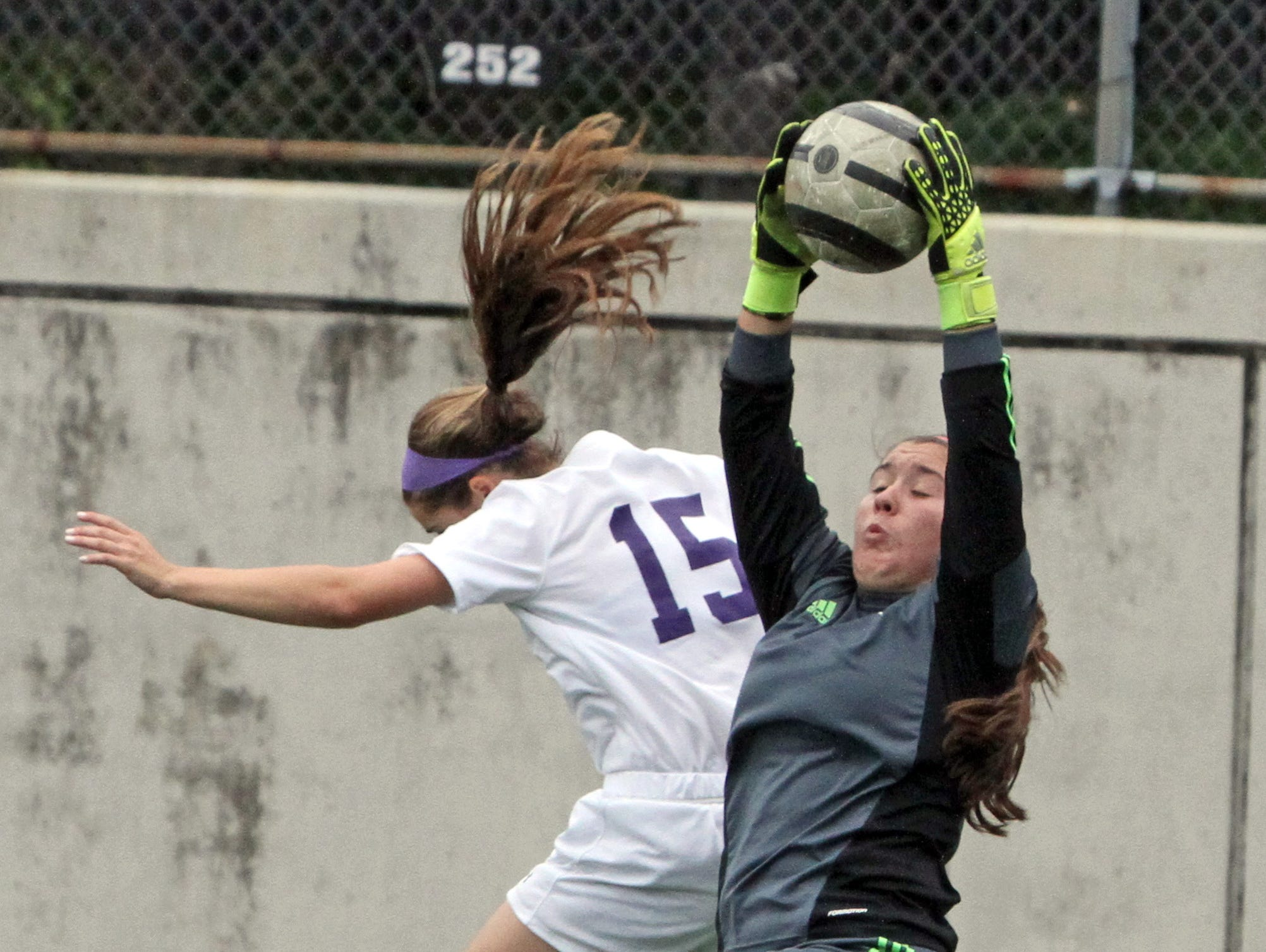 Ursuline keeper Jena Polinkovic makes the save as New Rochelle's Sophie Wolf pressures her during a varsity soccer match at New Rochelle High School Sept. 30, 3015.