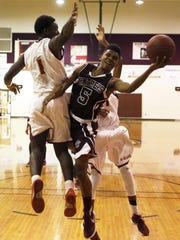 West Gadsden guard Andrew Reddick scores an acrobatic layup as part of his 13-point night against Florida High.