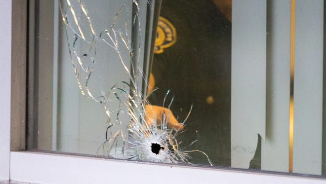 A visible bullet hole at IMPD North District headquarters, Friday, Oct. 14, 2016. For the second time in as many weeks, bullets were fired at a local police headquarters.