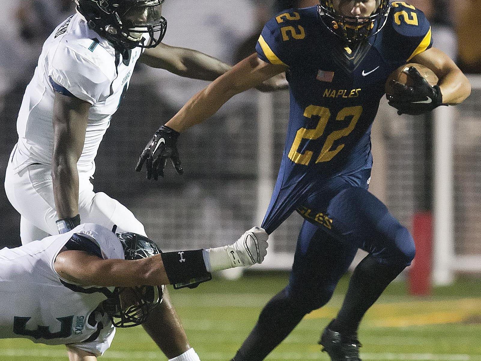Naples High School's Antonio Carbonaro gains a firt down against Gulf Coast on Friday at Naples High School.