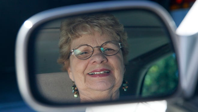 Sandy Wiseman is reflected in the rear view mirror  in Schaumburg, Ill., in this 2012 file photo