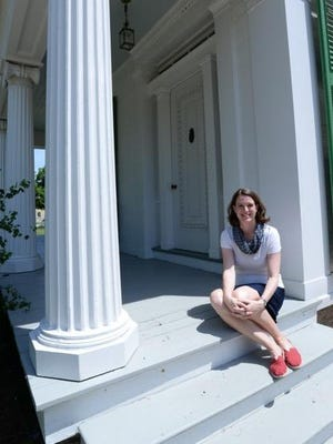 Becky Wehle, shown on the steps of the Livingston-Backus House, is the interim president and CEO for Genesee Country Village & Museum.