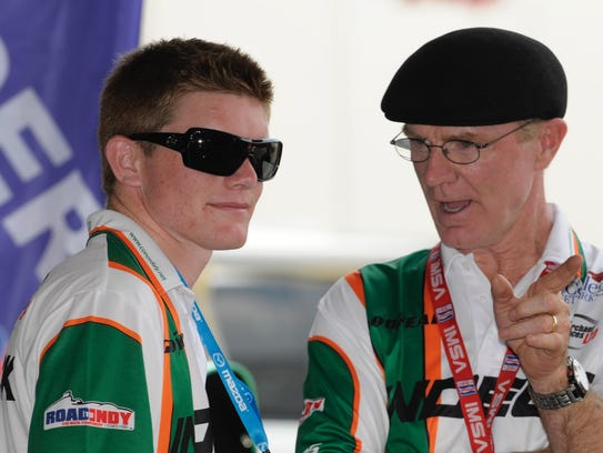 A young Conor Daly gets some coaching from his father,