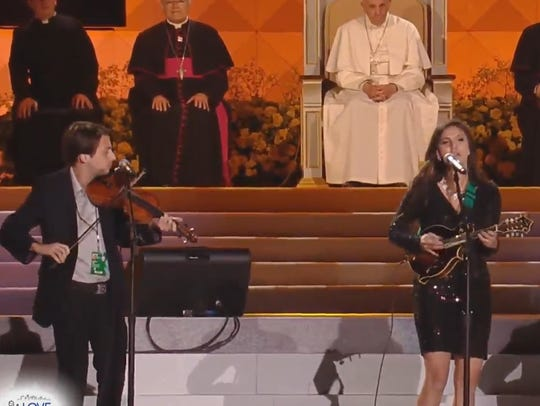 Pope Francis watches as performers take the stage at