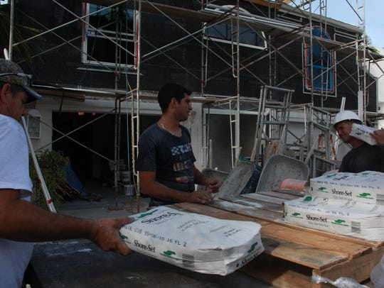Workers from Genuine Home Builders, Inc. based in Naples,