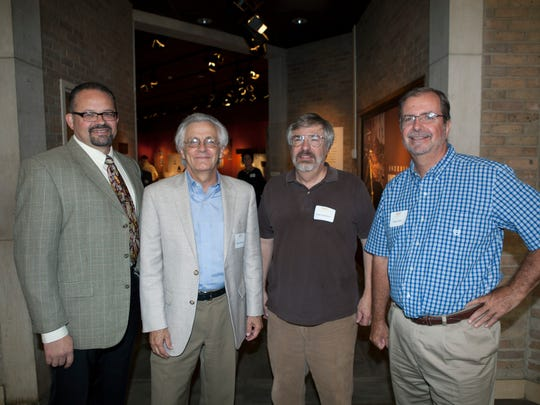 The curator of Knoxville Unearthed, Tim Baumann, poses with exhibition supporter and museum member Doug McCarty of McCarty Holsaple McCarty, and museum supporters Dave Anderson and Steve Dean at the opening.