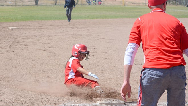 Loving's Tiana Rodriguez slides into third base in game one against Carlsbad JV on Saturday.