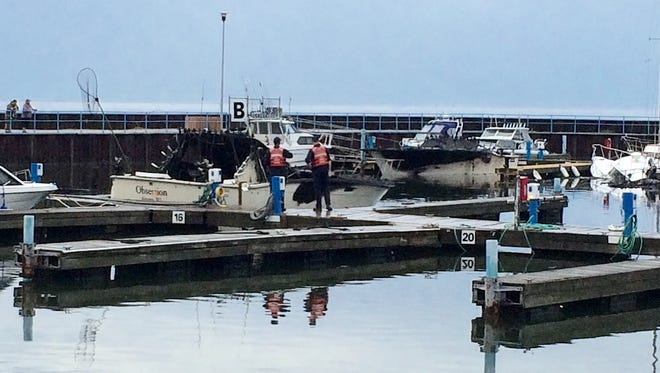 Three boats sank and two other sustained serious damage Thursday in a fire at Algoma Marina.