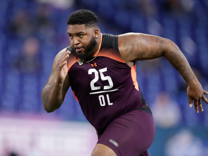 Alabama State offensive lineman Tytus Howard runs a drill at the NFL football scouting combine in Indianapolis, Friday, March 1, 2019. (AP Photo/Michael Conroy)