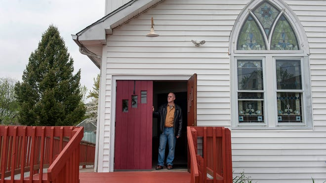 Rev. Edward Muska stands in the doorways at Mount Calvary Union Church in Runnemede on Thursday, May 8, 2014. The church suffered severe damage during a rain storm last summer and just recently was able to reopen after repairs were made through fundraising and volunteer efforts.