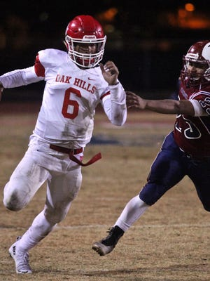 Oak Hills' Brandon Porter (6) fights for a few yards during the CIF semifinal with La Quinta on Friday.