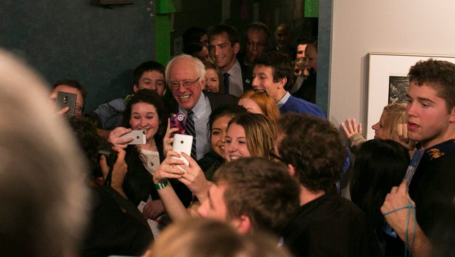Senator Bernie Sanders greets supporters following the Democratic debate on Saturday, November 14, 2015 at The Varsity Theater in Des Moines.