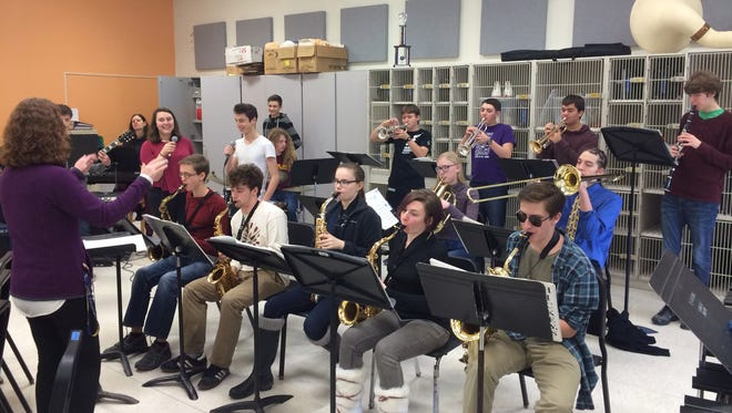 Hope Lewis, conducts members of the Charles O. Dickerson High School Jazz Band and Vocal Jazz Choir during rehearsals at the high school in Trumansburg as they prepare for Jazz Cabaret, which will be presented on Feb. 15.