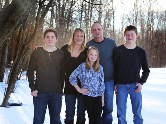 Milwaukee Fire Lt. Kristin Ciganek-Schroeder is surrounded by her husband, Bryon Schroeder, and their children Joshua, Ty and Samantha. Ciganek-Schroeder died of colon cancer. She was 47.