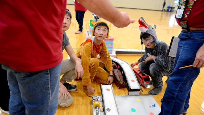 Ye Gui tells judges about his team's train track Thursday, May 21, 2015 after their routine was finished for their task at the Odyssey of the Mind World Finals at Michigan State University. Gui is part of a team from Yuepu Experimental School in Shanghai, China.