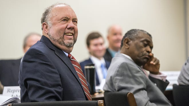 Rep. John Ager, D-Buncombe, left, asks a question at the Joint Appropriations Committee on General Government in  Raleigh.