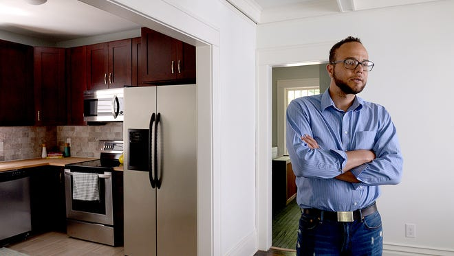 Jon Kolbasa, owner of Hip Homes, stands in the dining room describing the changes, updates and renovations to one of his houses on the market Wednesday on Michigan Avenue in the Westside Neighborhood. Kolbasa bought the home at an auction and refurbished the place.