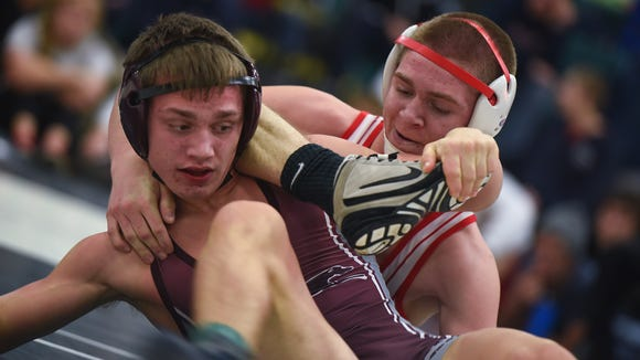 Bermudian Springs' Austin Clabaugh, top, grapples wirh Chandler Olson of Shippensburg during the Championship finals of the Carlisle Wrestling Tournament inside Carlisle's gym on Saturday Dec. 12, 2015, in Carlisle, Pa. Olson wins the 126 pound title with a 5-0 decision.