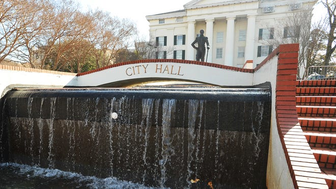 Two city employees arrested