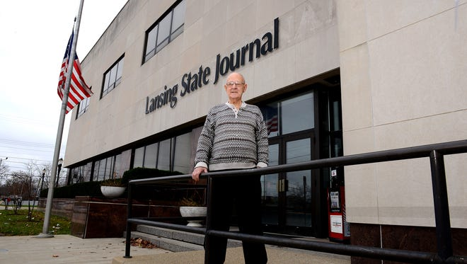 Longtime Lansing State Journal Onlooker columnist Jim Hough stands outside the old State Journal building in December.