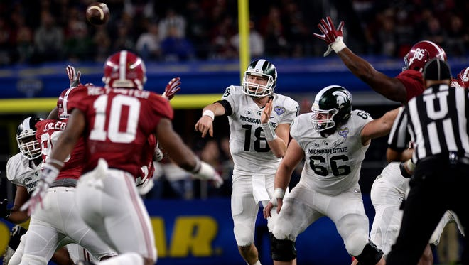 Quarterback Connor Cook throws downfield in the second half of Alabama's 38-0 win over Michigan State in the 80th Annual Cotton Bowl Classic Thursday, December 30, 2015 in Arlington, Texas.