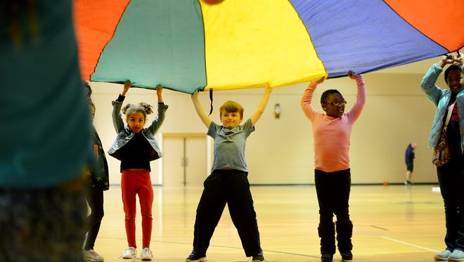 Children participating in the Caine Halter YMCA After School Program play in the gym on Wednesday.