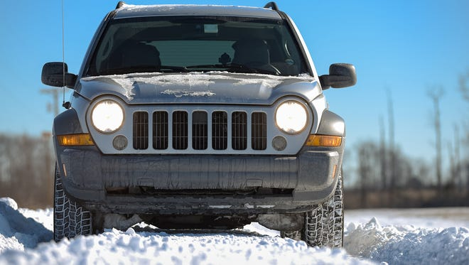 A Jeep gets the photographer through the flooded, snow covered, and drifted over Woodland Beach Road on Sunday morning.