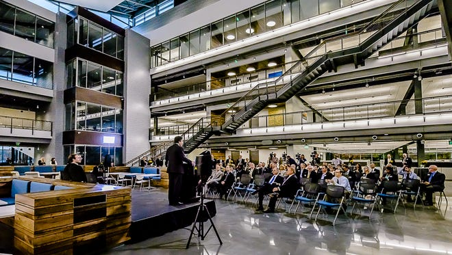 Barry Stowe, chairman of Jackson National Life Insurance Co., addresses a crowd during a media tour at the grand opening of the insurance company's $60 million expansion building in October 2015.