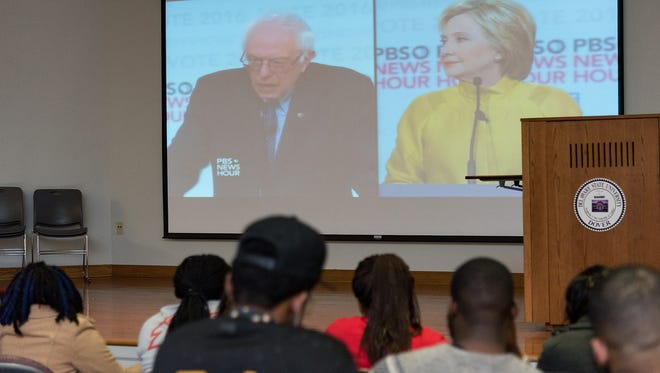 Members of the DSU College Democrats hold a watch party for the democratic debate in the Bank of America building on the Delaware State University campus on Thursday night. U.S. Sen. Bernie Sanders is scoring big points with young voters.
