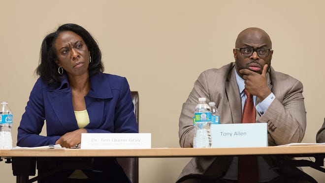 Teri Quinn Gray, president of the State Board of Education, and Tony Allen, chairman of the Wilmington Education Improvement Commission, answer questions during a discussion about Wilmington school redistricting plans Wednesday in Wilmington. The State Board's authority to redistrict expires next month.