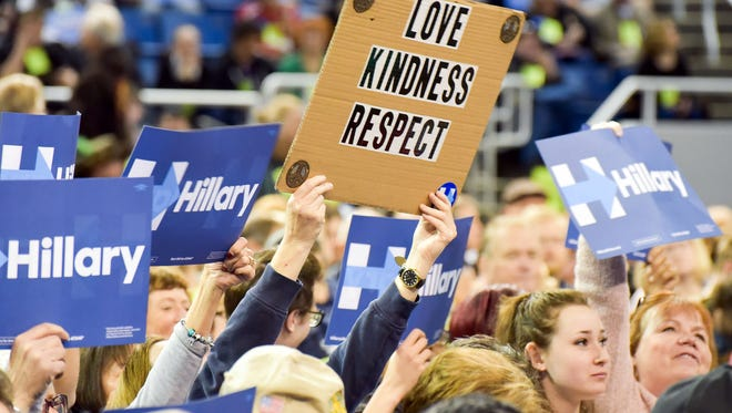 """At the Washoe County Democratic Convention, Hillary Clinton supporters helpd up signs, including this one that read """"Love kindness respect."""" April 2, 2016."""