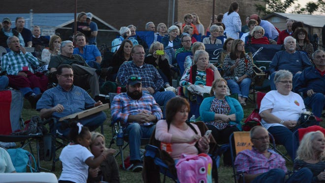 Hundreds of people gathered to hear the Kimberlie Helton Band during the kickoff of the 3rd Season of The AMP at the Market, Friday, May 6, 2016.
