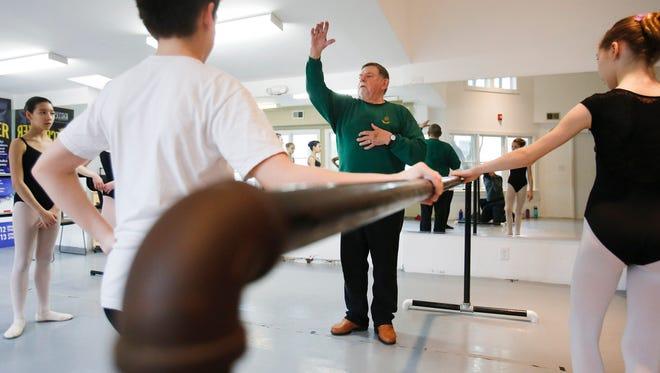Arthur Hutchinson teaches a ballet class at Wilmington Ballet Academy of the Dance.
