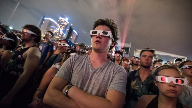 Fans wear 3-D glasses to watch the Kraftwerk 3-D show on the main stage during the Movement Electronic Music Festival.