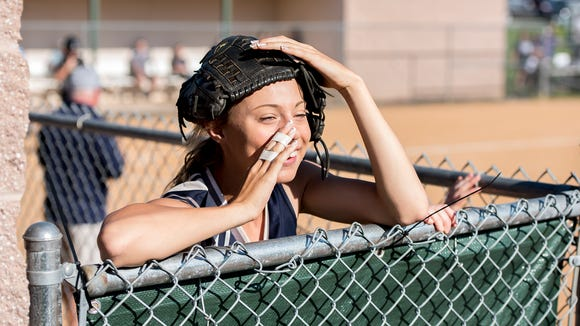 Chambersburg Lexi Leedy riles up Trojan fans getting them to cheer with her during a PIAA Class AAAA quarterfinal softball playoff on Thursday, June 9, 2016 played in Carlisle, Pa.