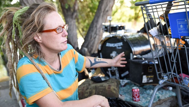 Aphyr Feeney and her dog live outside next to the Truckee River. On June 29, Reno Police, Sparks Police and local service providers swept the river to find people in need of services. Feeney said she has been homeless with her boyfriend for three years. She uses a large area and has a drum set, several carts full of belongings and food and a motor scooter.