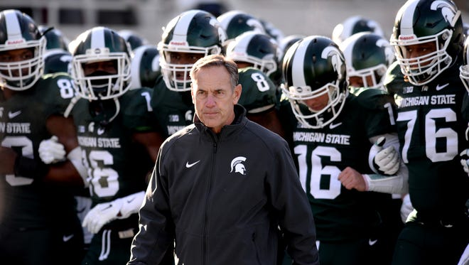 Mark Dantonio, here taking the field for the final home game of last season, has coached MSU to 65 wins over the last six years – and a lot more respect than is perceived.