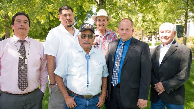 From left, Vinton Hawley, chairman of the Pyramid Lake Paiute Tribe; Bobby Sanchez, chairman of the Walker River Paiute Tribe; Robert James, Johnnie Williams, Rendal Miller, attorney for the tribes and Alvin Moyle, of Four Directions, Inc.. The group posed in front of the federal courthouse in Reno after filing an injunction claiming unconstitutional voting access in Washoe County.