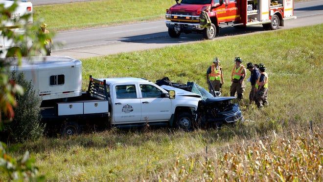 First responders on the scene of a fatal three-car crash on EB I-96 EB Monday, Sept. 19, 2016, near Williamston.