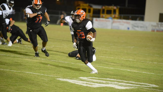 South Gibson's Dre McAllister runs the ball up the field against South Side last season.